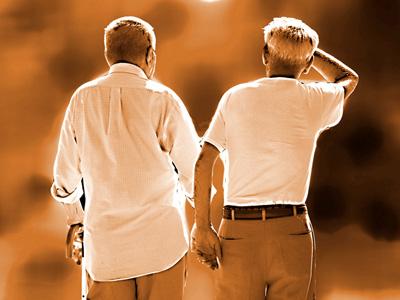 Two older men walking together.