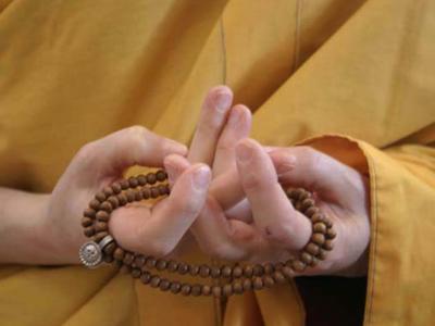 Mandala offering mudra.
