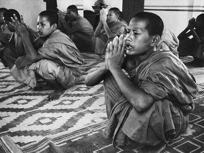 Young monks meditating.