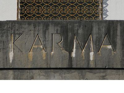 The word 'Karma' carved in stone.