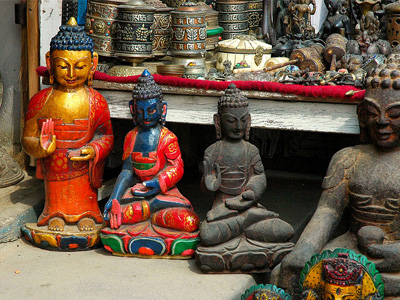 Four small Buddha statues.
