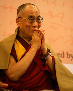 His Holiness the Dalai Lama with palms together.