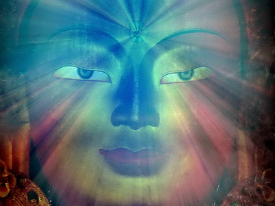 Transparent rainbow image of a Buddha's face.