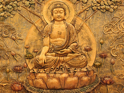 A copper-plate picture of a sitting Buddha.