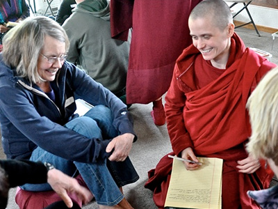 Venerable Jampa smiling during a discussion with an Abbey retreatant.