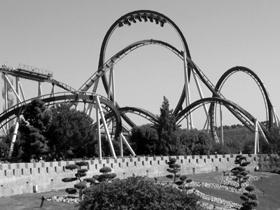 Black and white image of a roller coaster.