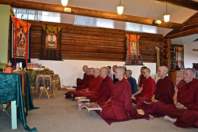 Abbey monastics chanting during a Medicine Buddha puja.