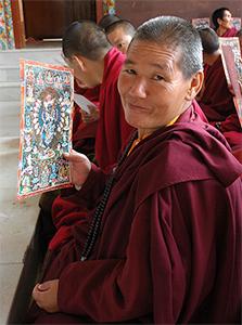 Tibetan nun smiling.
