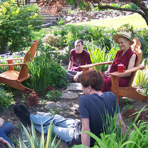 Venerable Chodron having a discussion outside with a group of youth.
