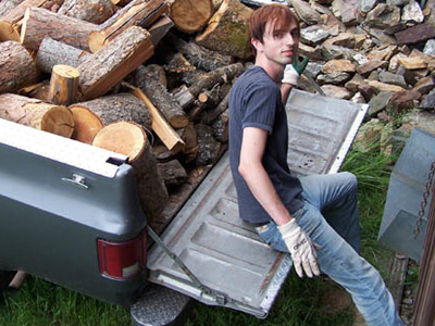 Karma unloading next winter's firewood from the Abbey truck.