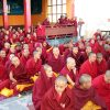 Tibetan nuns sitting and waiting.