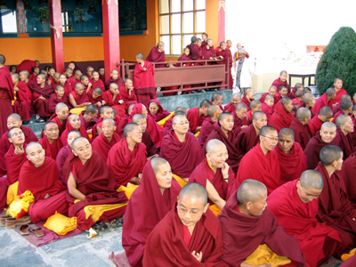 Tibetan nuns sitting and waiting.