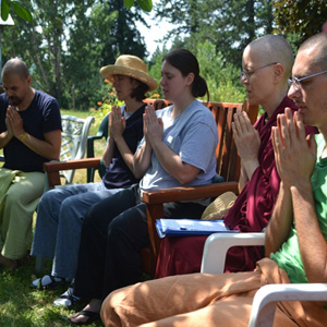 Exploring Monastic Life (EML) retreatants sitting in chairs praying.