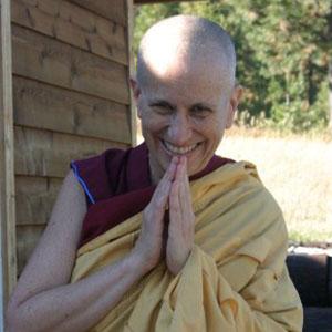 Venerable Thubten Chodron smiling happily.