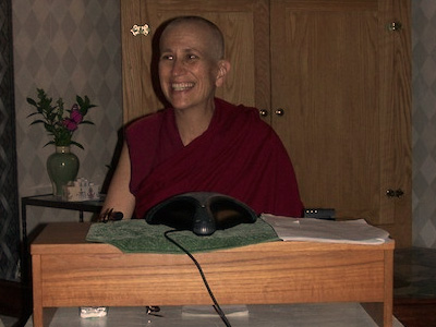 Venerable giving a talk during Medicine Buddha retreat.