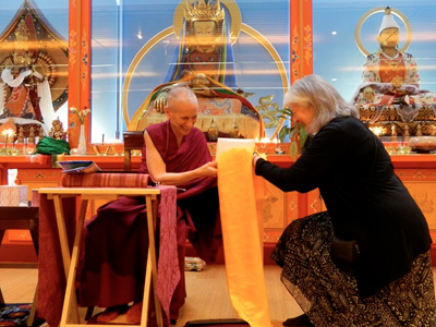 Venerable receiving an offering after a teaching at Maitripa.