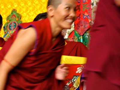 A Tibetan nun smiling.