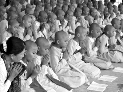 Young buddhist nuns chanting.