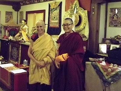 Venerable Chodron and Venerable Tenzin Kacho, standing in front of an altar at Vajrapani Institute in Boulder Creek.
