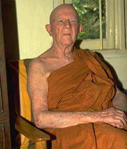 Bhante Nyanaponika sitting in a chair.