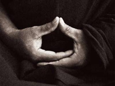 Hand in meditation position.
