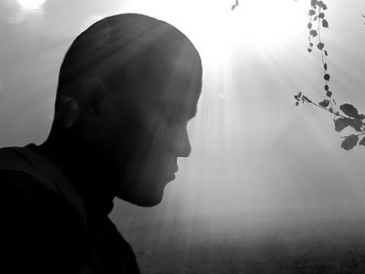 Silhouette of man with highlight behind his head.
