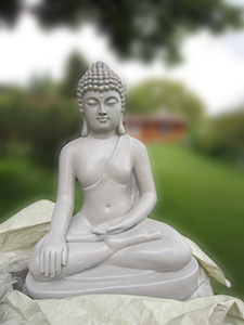 A white Buddha statue on the lawn at the Abbey.