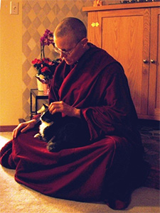 Venerable Tarpa holding the cat Achala.