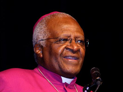Archbishop Desmond Tutu giving a speech.