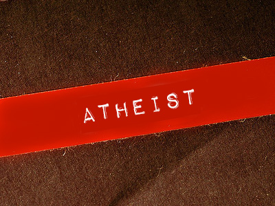 The word 'atheist' on a red label.