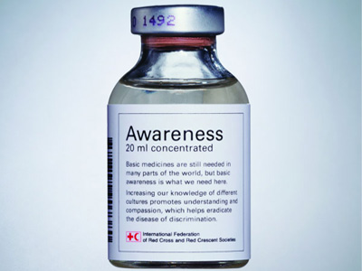 A glass medicine bottle with the label Awareness, 20ml concentration, Basic medicines are still needed in many parts of the world, but basic awareness are what we need here. Increasing knowledge of different cultures promotes understanding and compassion, which helps eradicate the disease of discrimination.