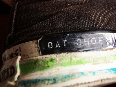 Sneaker with the label 'Bat Shoes' on it.
