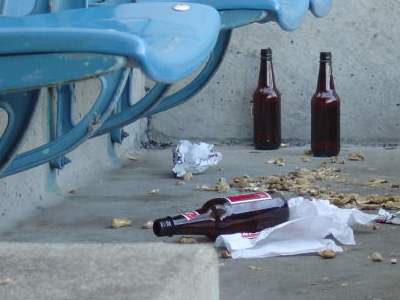 Empty beer bottles and trash on the ground.
