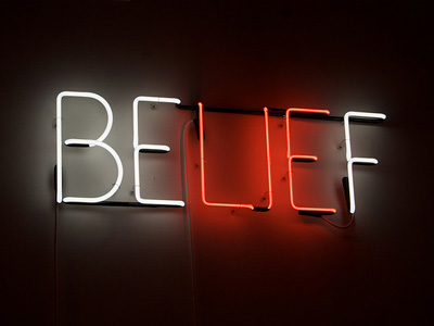 Neon sign of the word belief with lie highlighted.
