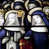 Stained glass image of Benedictine nuns.