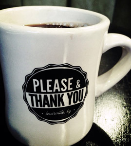 A cup with the words: Please & Thank You.
