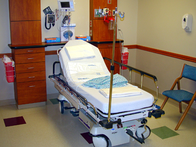 An empty hospital bed.