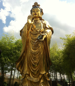 A very tall statute of Kwan Yin in Singapore.