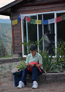 An Abbey retreatant studying near the Meditation Hall.