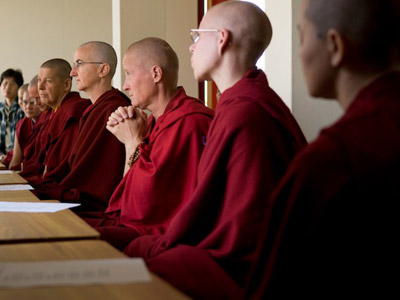 Venerable Tenzin Sangmo (hands folded together), the Dutch nun who founded and runs Thösamling, and Venerable Lhundup Damchö, to her left, are among those listening intently to Venerable Chödron's Dharma talk.
