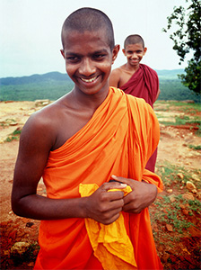 Two smiling Sri Lankan monks.