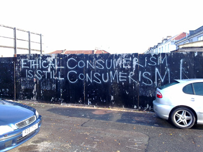 A wall with the word Ethical consumerism is still consumerism.