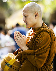 A Thai monk with palms together.