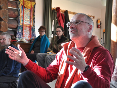 Abbey retreatant in discussion during a Dharma talk.
