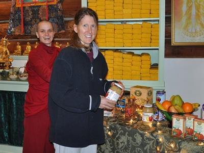 Venerable Jampa and Heather, arranging the altar.