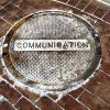 A cover with the word Communication