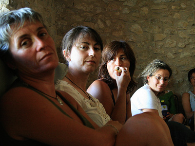 A group of women waiting for a group therapy session to begin.