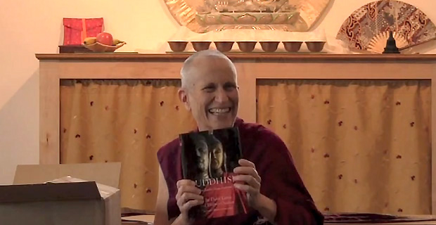 Venerable Chodron holding the new book.