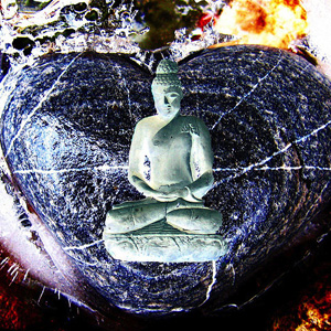 Statue of a Buddha in front of a heart-shaped stone.
