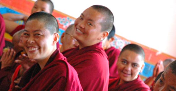 Tibetan nuns smiling.